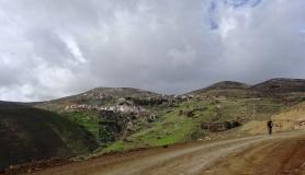 mountain biker and Kapetaniana village