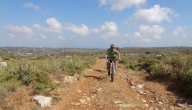 the pastures at the first section of Agarathos mountain bike tour