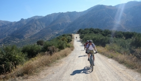 Riding to the top of the tour. The panoramic view of Dikti canyons