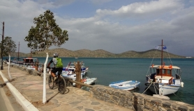 elounda Crete. cyclist and the boats at the port