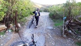 cyclists passes a door at Pera Galini area