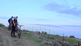 cyclists gaze the full moon at Monodendri mountain Monofatsi Crete