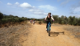 pretty lady cyclingcreta bike rentals Crete guided tours