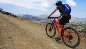 beautifull lady ascentds to katharo Plateau from Mesa Lasithaki Crete
