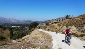 team of cyclists uphill to Katharo