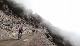 riding in the mist through the pine forest of Koudoumas