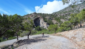 the pine forest of Koudoumas and the caves in the rocks