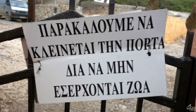 sign at the entrance of Koudoumas Monastery
