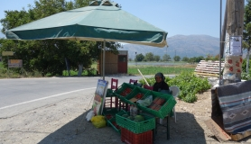 old lady sell fruits at the north entrance of Lsithi Plateau