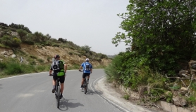 cyclist at the point where a small downhill starts