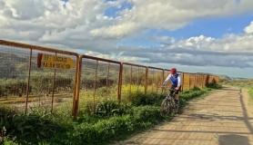 stone village bike tour Agios Thomas airport fence