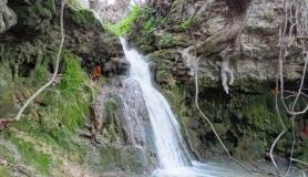 stone village bike tour Agios Thomas waterfall at agios georgios chostos