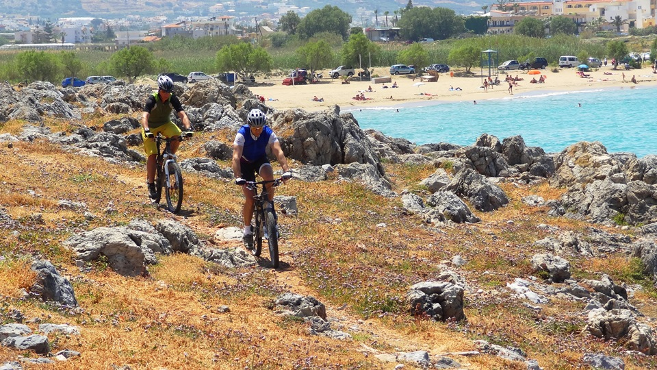 cyclist ride the path from potamos beach Malia to Sisi