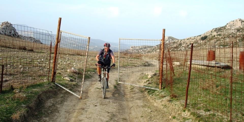 cyclist and metal door outdoors