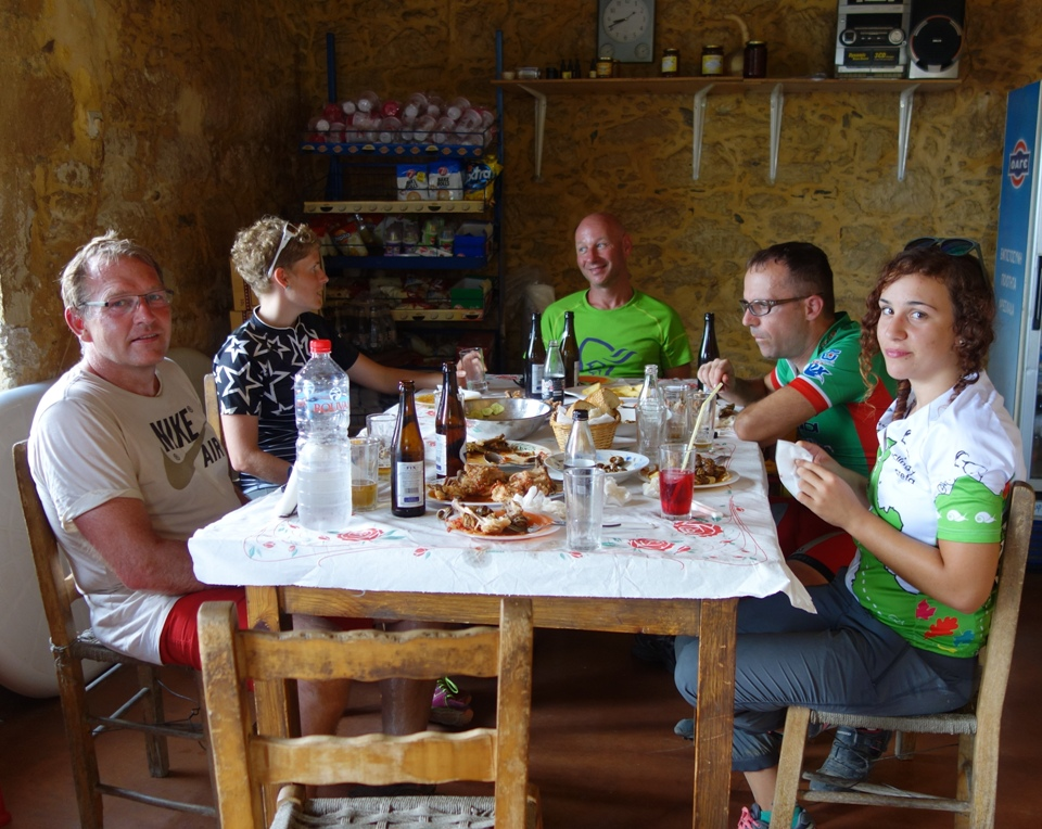cyclists have dinner after bike tour at Tripiti
