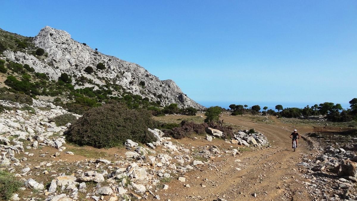 mountain biker ascends to omalos plateau crete