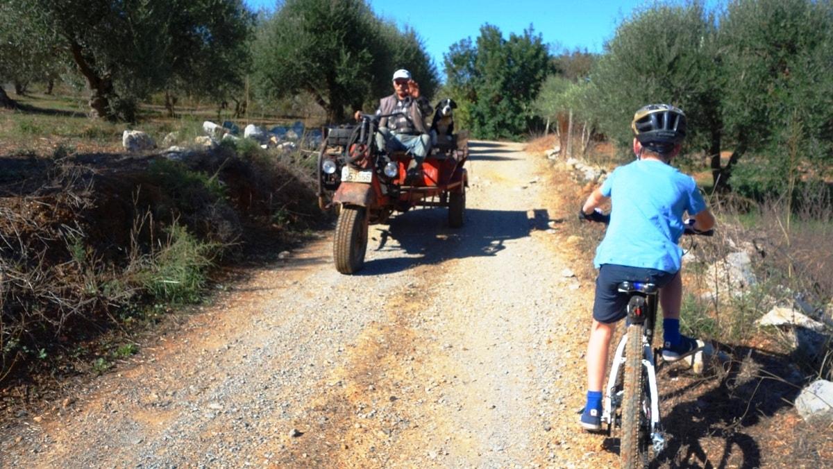 boy cycling around mochos plateau crete