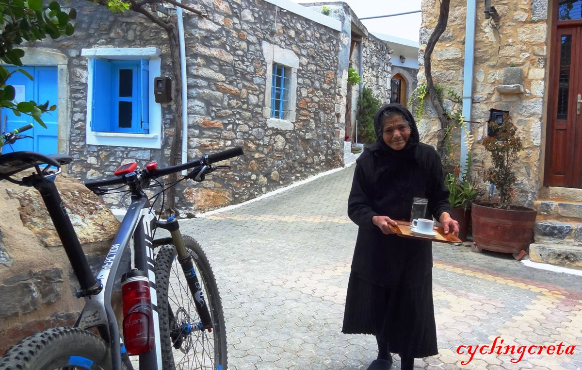 coffee stop at karouzano village crete old lady serving the foffee