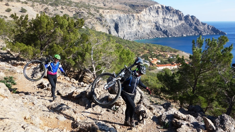 carrying bikes at koudoumas monastery crete -min