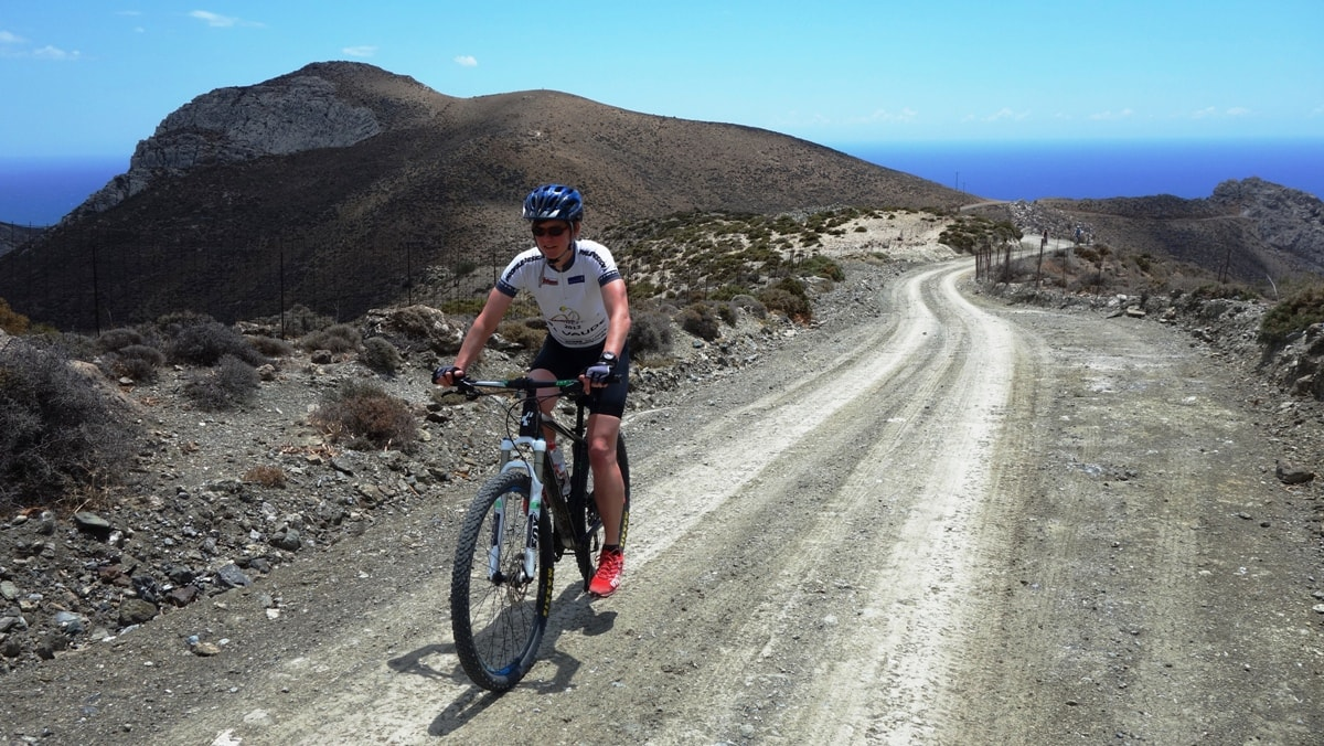 pretty lady cycling in crete asterousia mountains