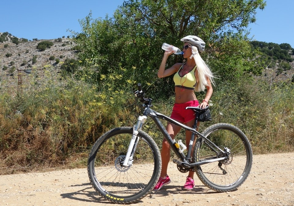pretty girl at Lasithi plateau cycling crete bike - feature