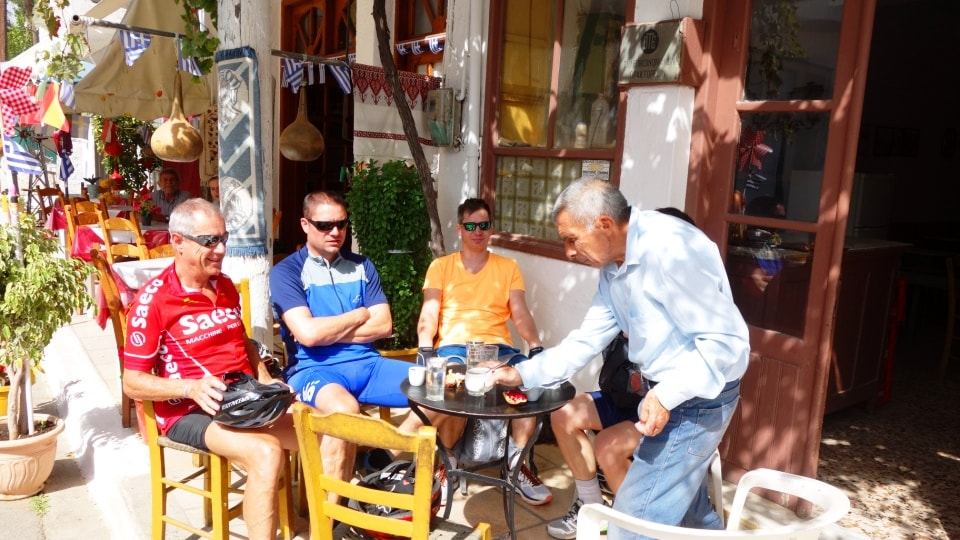 4 cyclists rest at a trditional cafe on the mountains of Crete after a amazing bike tour
